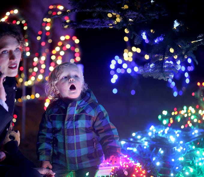 The Kingston Cove Christmas celebration on Saturday, December 1, 2018, at Mike Wallace Park in Kingston.The highlight of the event was the arrival of Santa and the Christmas tree, and park lighting. Camlyn Anderson,of Kingston  with her son Shay, 1, as he is awe of the lights under the Christmas Tree that had just been turned on.