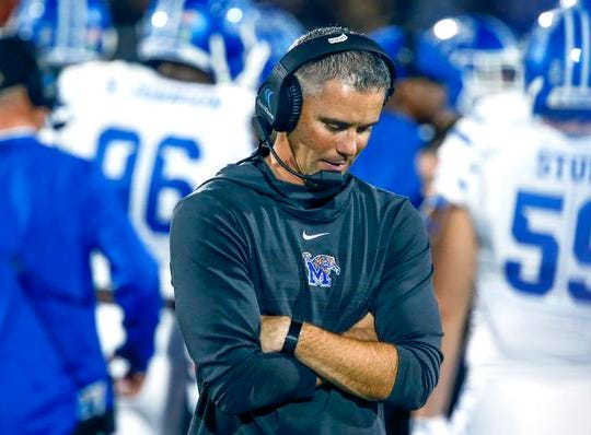Memphis Tigers head coach Mike Norvell walks the sidelines in the closing minutes of second half against the UCF Knights at Spectrum Stadium.