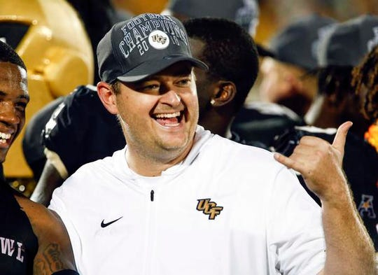 UCF Knights head coach Josh Heupel celebrates a win following a win over the Memphis Tigers at Spectrum Stadium.