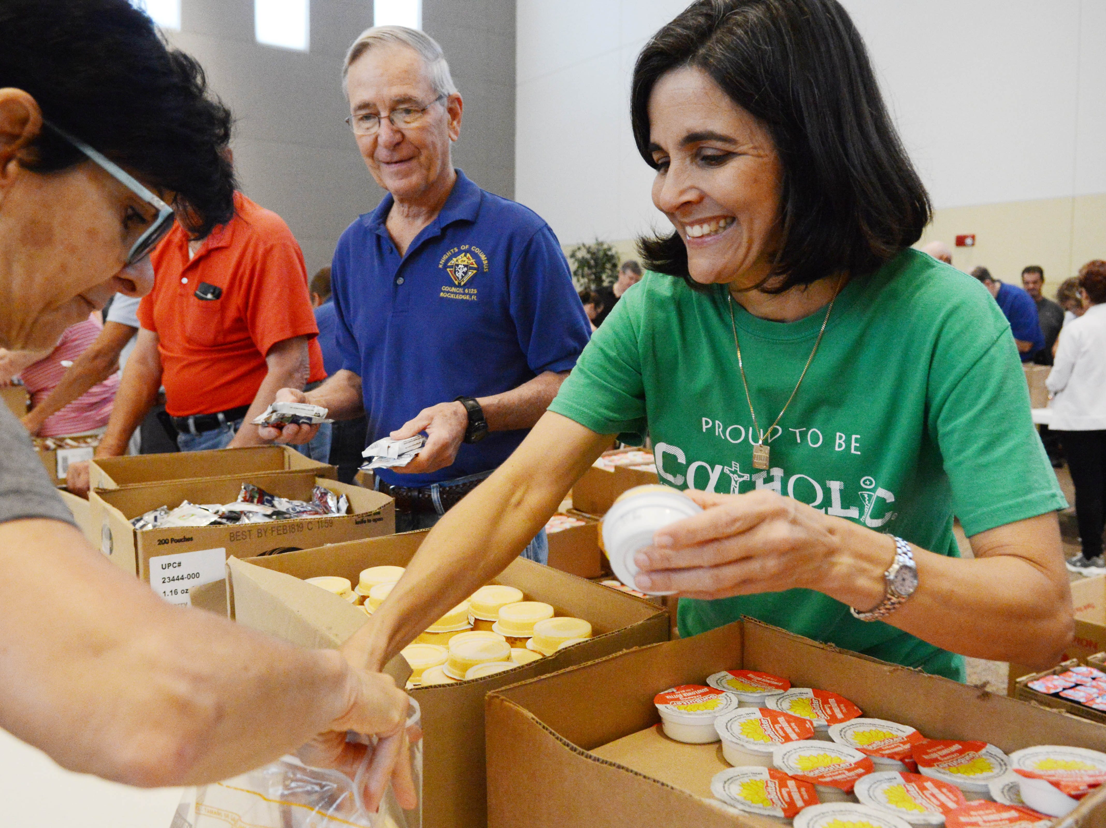 Hundreds of volunteers showed up at St. John the Evangelist Church in Viera to help pack lunch kits for The Children's Hunger Project. Their goal was to pack 5000 weekend kits for needy children in the area who may go without during the weekend.