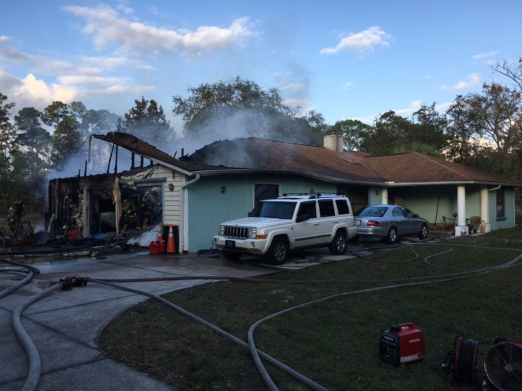 "Fire crews managed to contain the blaze to the attic and garage, though both suffered ""heavy damage,"" official said."