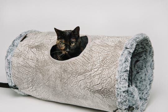 The Purr and Pounce Cat Tunnel($59.90) has a peephole for spying on humans.