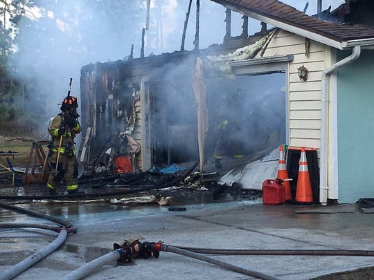 """Fire crews managed to contain the blaze to the attic and garage, though both suffered """"heavy damage,"""" official said."""