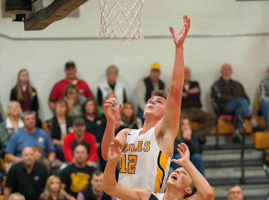 Colonel Crawford's Gavin Feichtner jumps up for a rebound.
