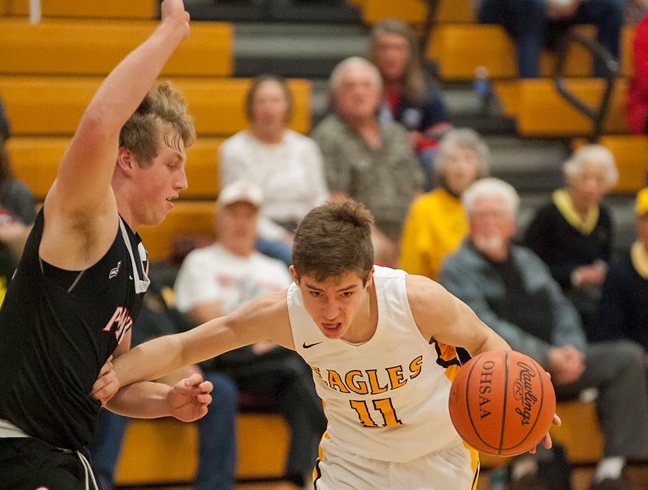 Colonel Crawford's Mason Studer dribbles at the top of the key.