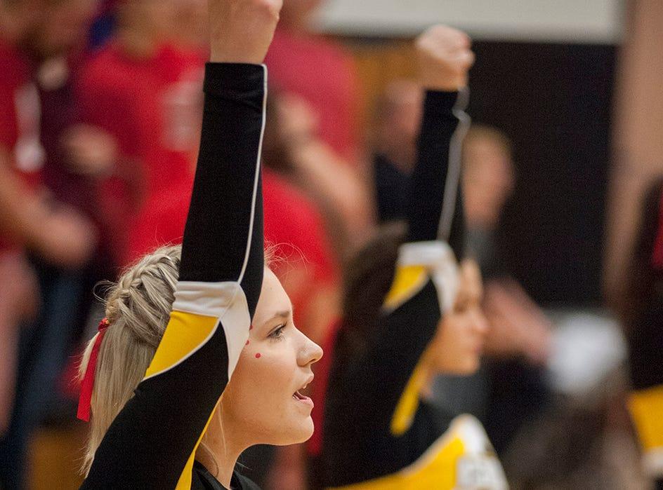 Colonel Crawford cheerleaders cheer on the team against Perkins.