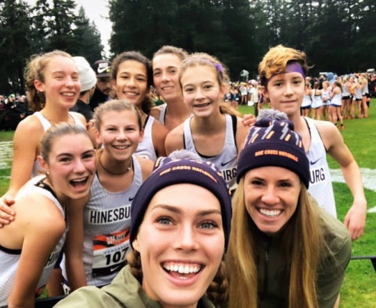 The CVU team poses for a selfie with U.S. runners Colleen Quigley and Courtney Frerichs at the Nike Cross Nationals on Saturday.
