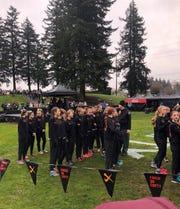 The CVU team preps before Saturday's Nike Cross Nationals.