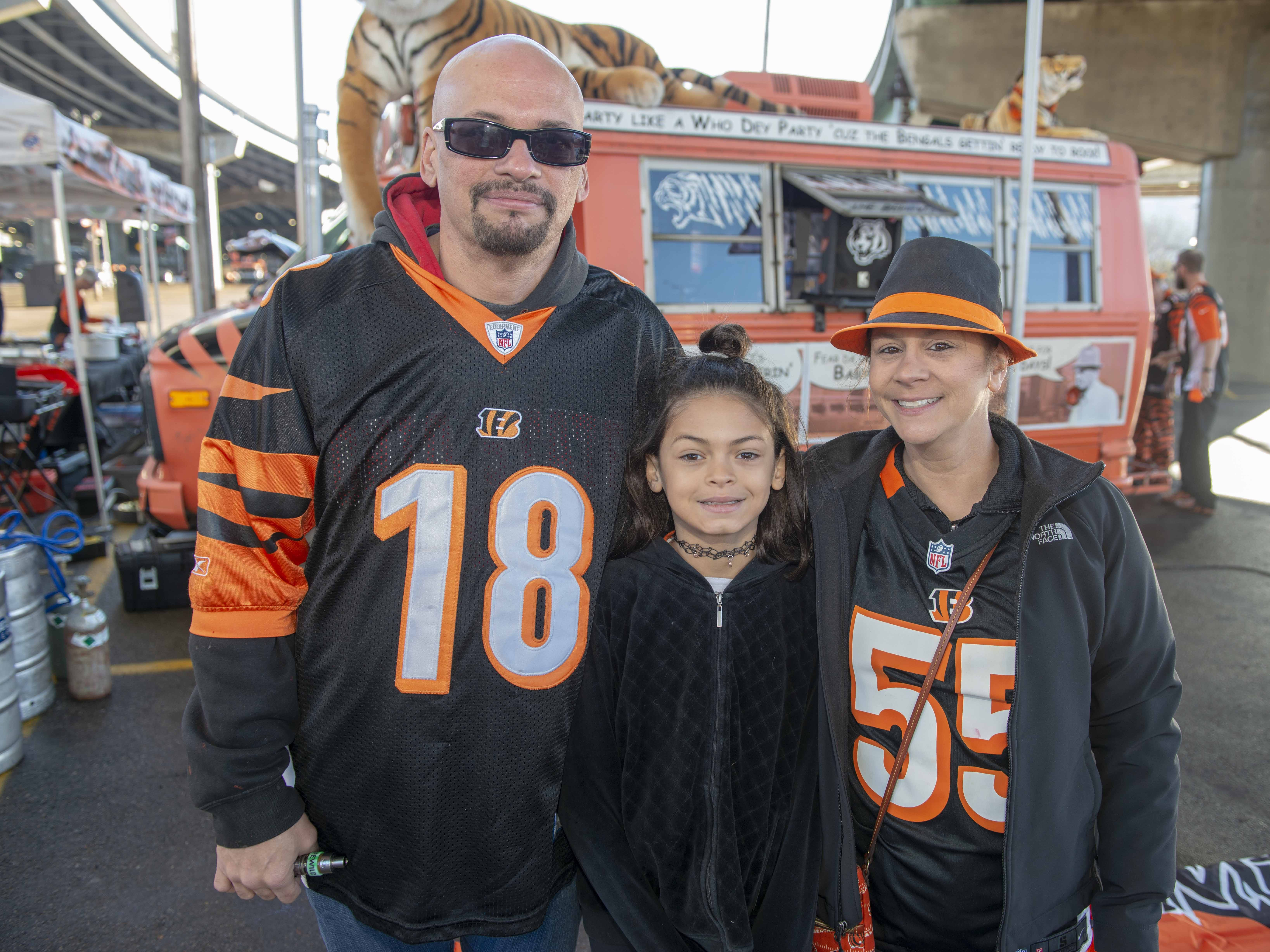 Cincinnati Bengals fans showed up for tailgating parties as the Cincinnati Bengals hosted the Denver Broncos at Paul Brown Stadium Sunday, December 2, 2018. Corey Glancy, Mariah Ravenscraft and Kasandra Glancy from Sharonville.