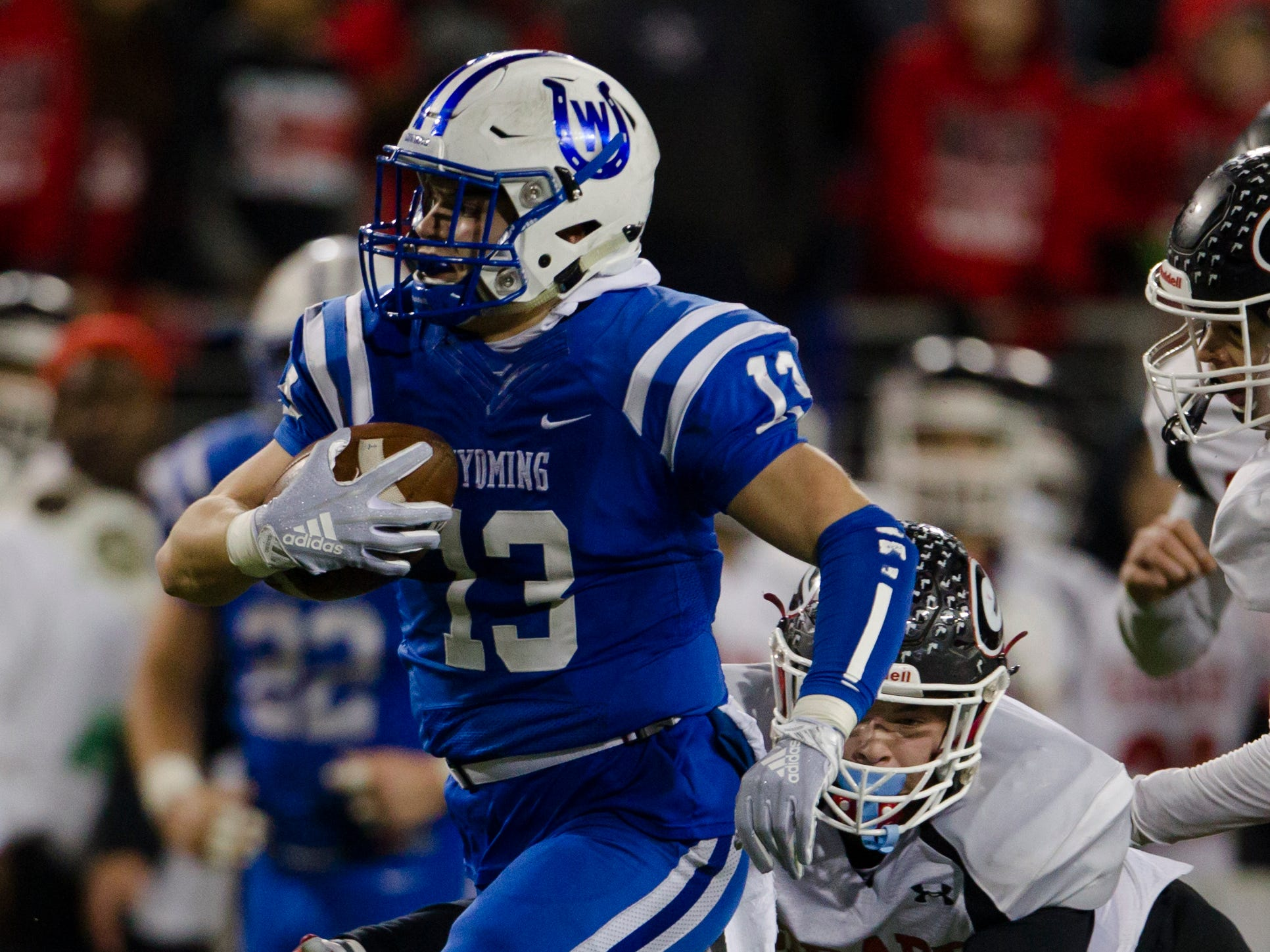 Wyoming's  Joey Edmonds (13) runs downfield during the first half of the OHSAA Division IV State Championship football game between Wyoming and Girard on Saturday, Dec. 1, 2018, at Tom Benson Stadium in Canton.