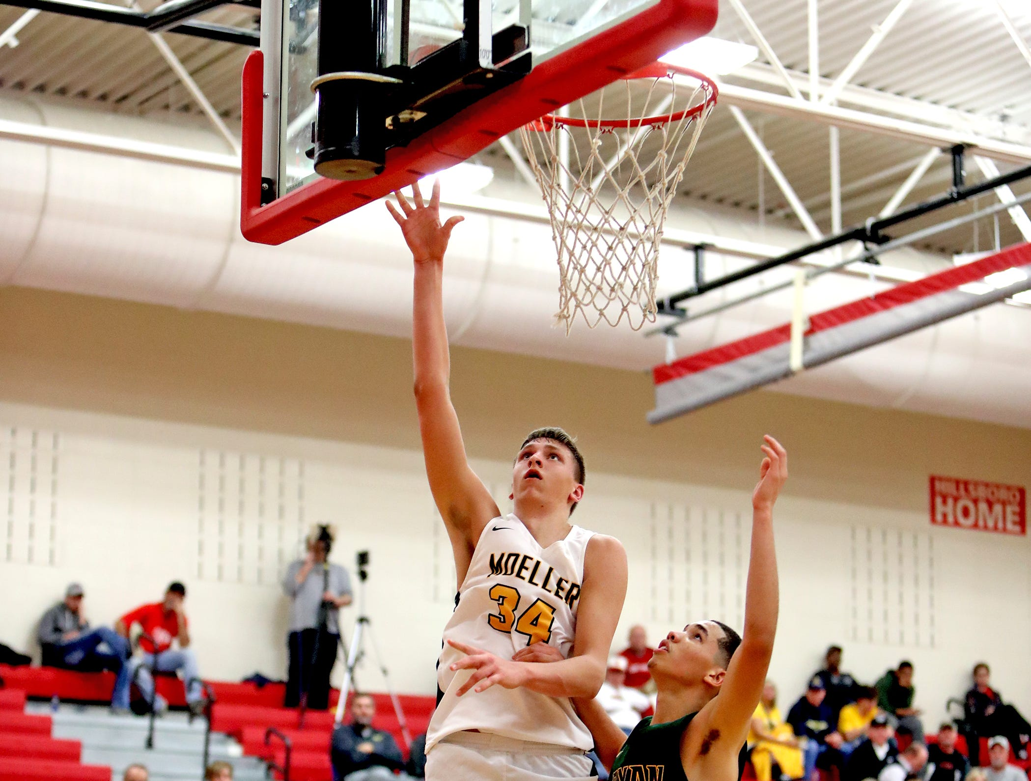 Moeller center Logan Duncomb scores at the Ohio Valley Hoops Classic at Hillsboro High School. Moeller defeated Bryan Station 85-42.