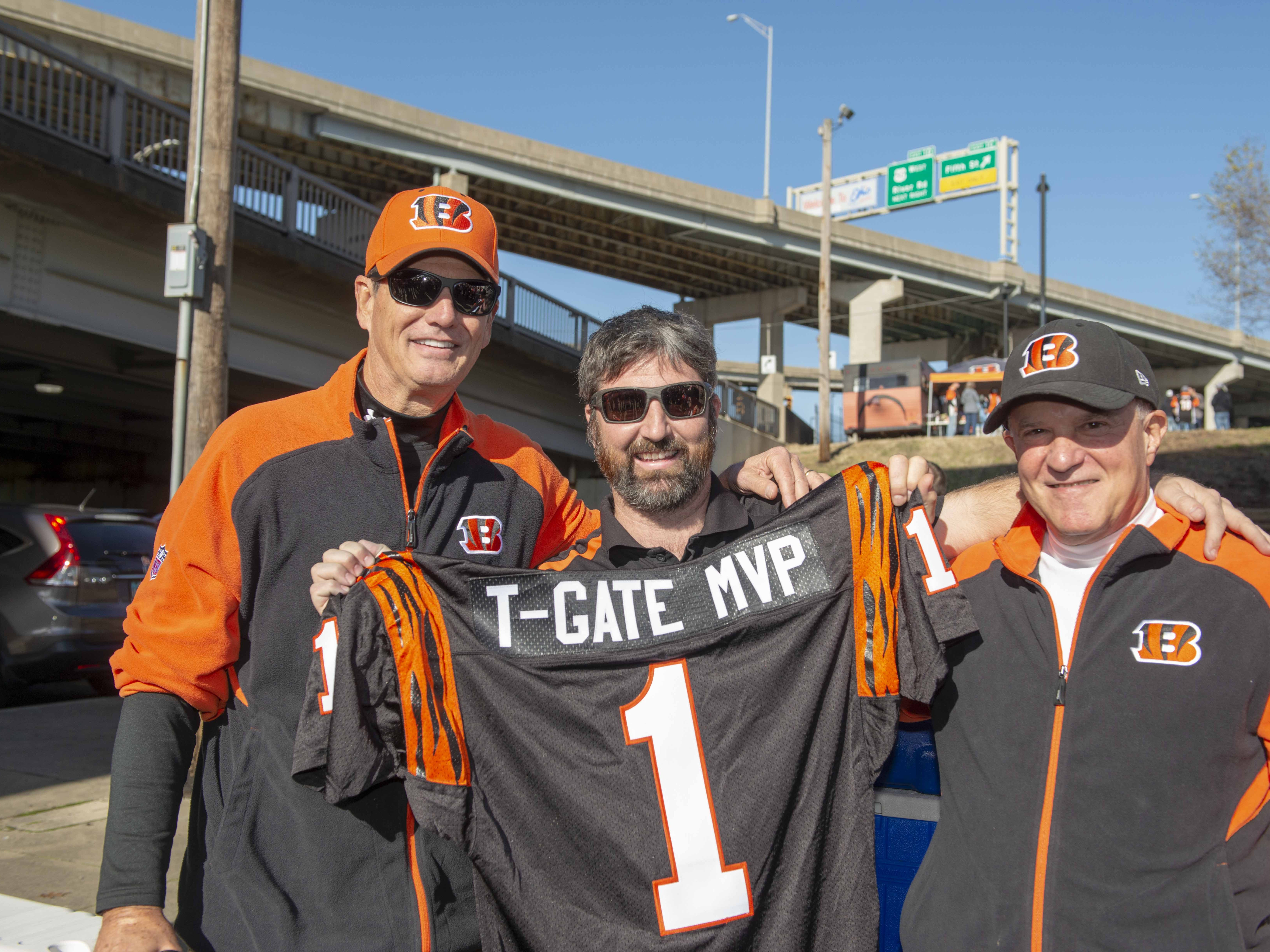 Cincinnati Bengals fans showed up for tailgating parties as the Cincinnati Bengals hosted the Denver Broncos at Paul Brown Stadium Sunday, December 2, 2018. Dave Loper and Fred Robbins present the tailgate MVP Award to Brendan McAndrew for his great effort all year.