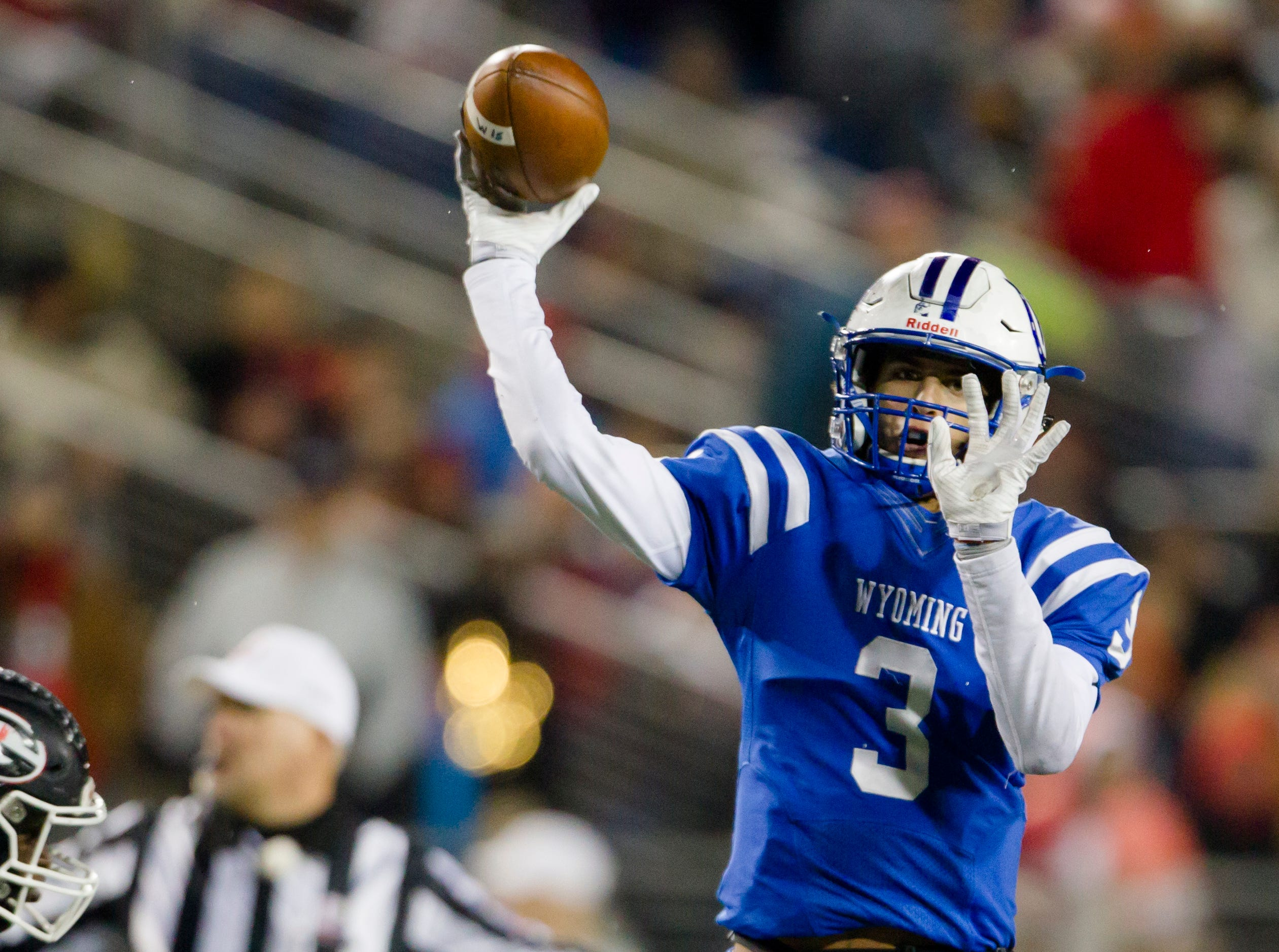 Wyoming's Evan Prater (3) throws a pass during the first half of the OHSAA Division IV State Championship football game between Wyoming and Girard on Saturday, Dec. 1, 2018, at Tom Benson Stadium in Canton.