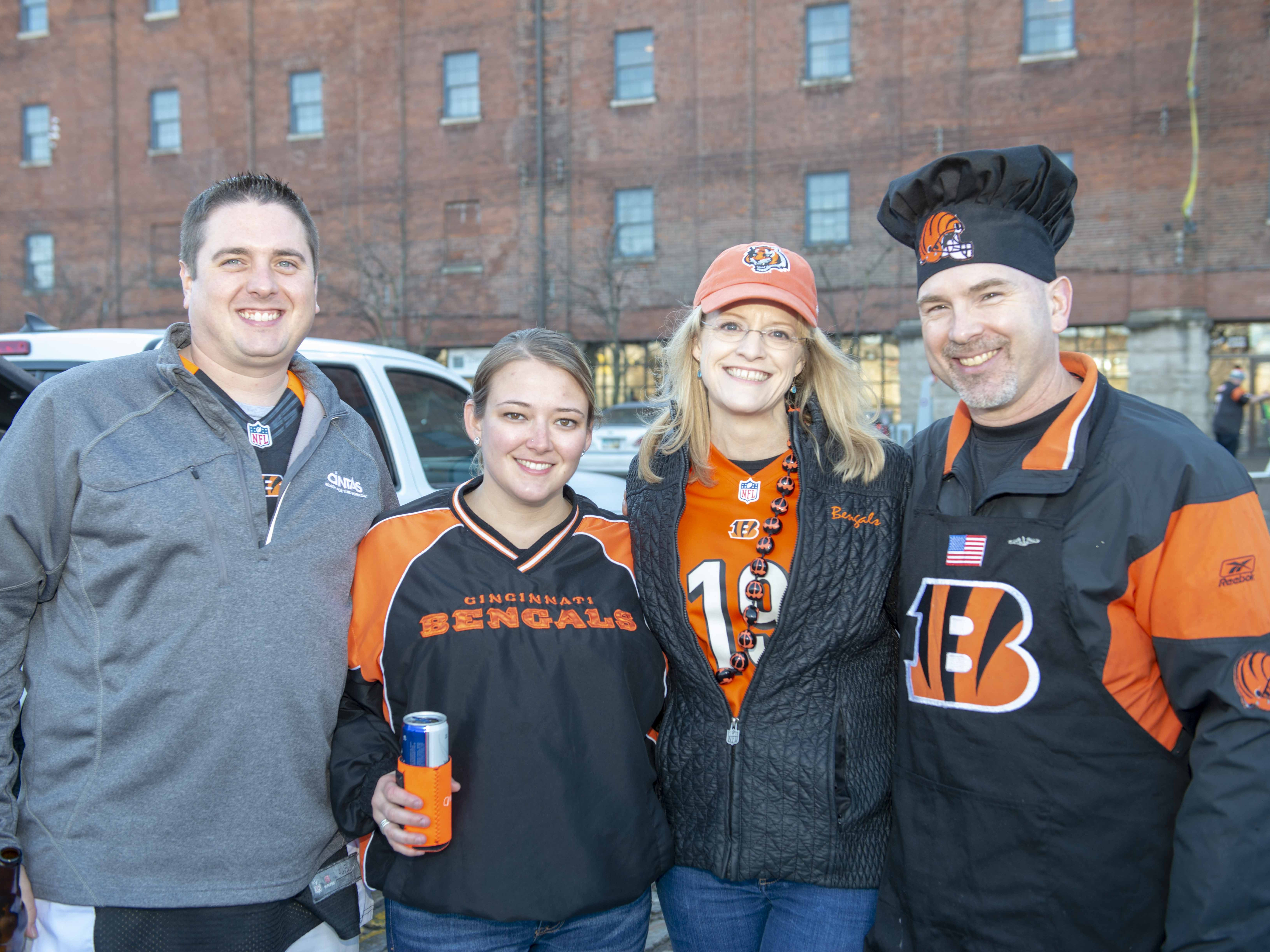 Cincinnati Bengals fans showed up for tailgating parties as the Cincinnati Bengals hosted the Denver Broncos at Paul Brown Stadium Sunday, December 2, 2018. Jonathan and Katelyn Sotten of Hamilton and Wendy and Ken Adams of West Price Hill.