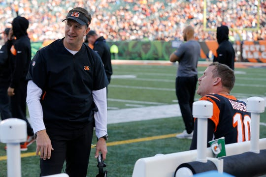Special teams coach Darrin Simmons and Cincinnati Bengals punter Kevin Huber (10) argue after a punt play in the second quarter of the NFL Week 13 game between the Cincinnati Bengals and the Denver Broncos at Paul Brown Stadium in downtown Cincinnati on Sunday, Dec. 2, 2018. The Broncos led 7-3 at halftime.