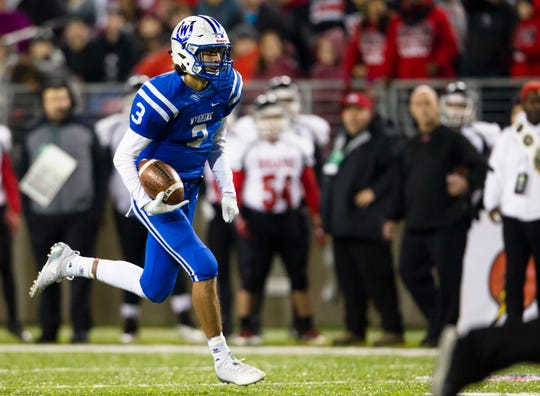 Wyoming's Evan Prater (3) runs for a touchdown during the first half of the OHSAA Division IV State Championship football game between Wyoming and Girard on Saturday, Dec. 1, 2018, at Tom Benson Stadium in Canton.