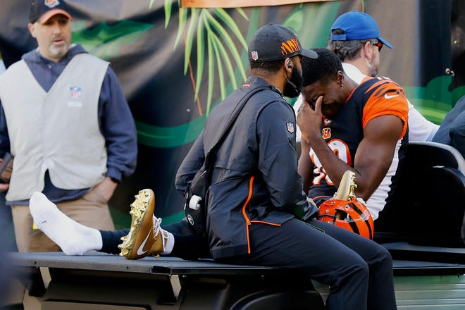 A.J. Green gets emotional as he is carted off the field on Sunday as he re-aggravated the toe injury that kept him out the last three games.