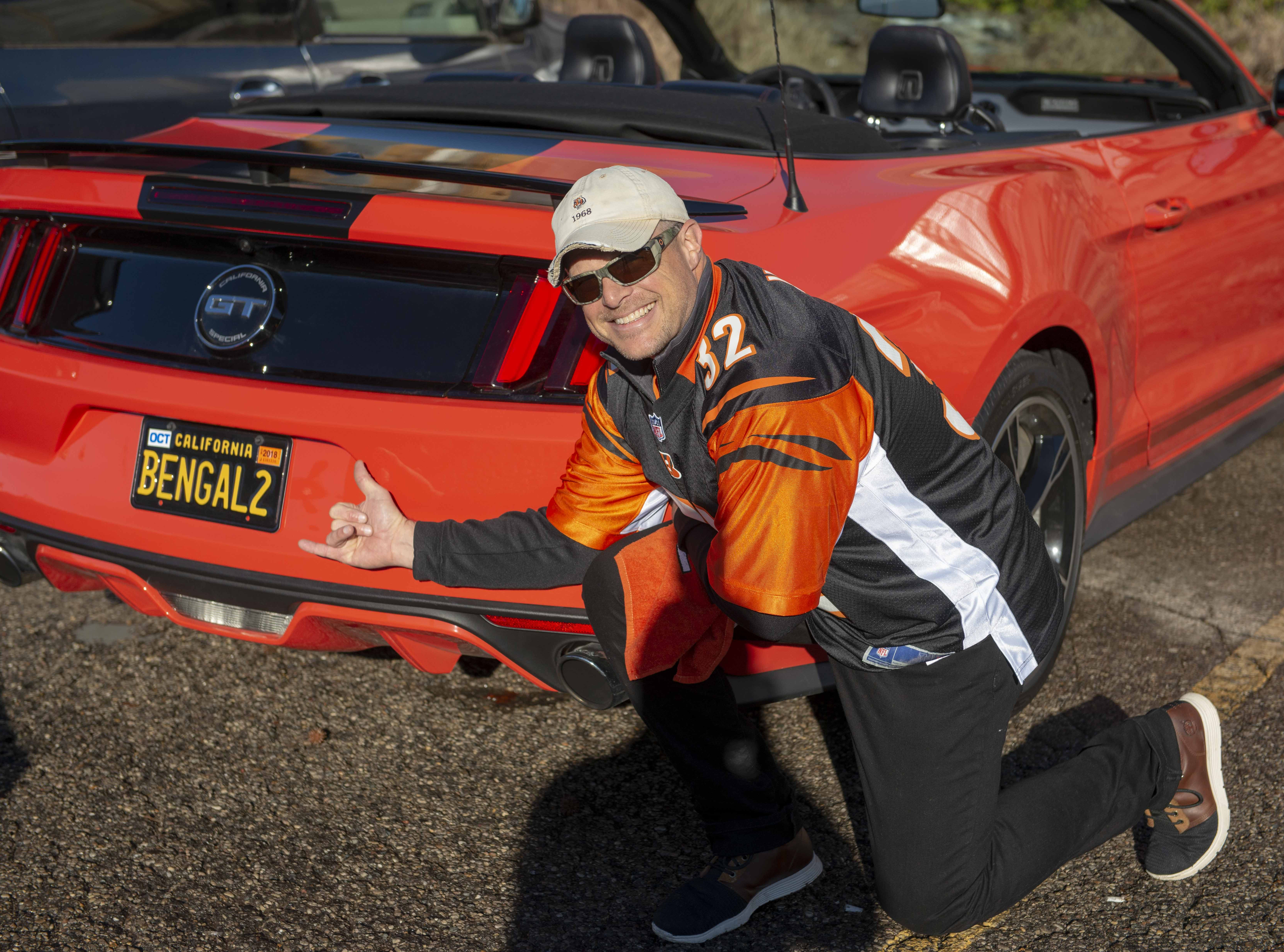 Cincinnati Bengals fans showed up for tailgating parties as the Cincinnati Bengals hosted the Denver Broncos at Paul Brown Stadium Sunday, December 2, 2018. Brian HIll of Union, Kentucky, with his 2016 Mustang.