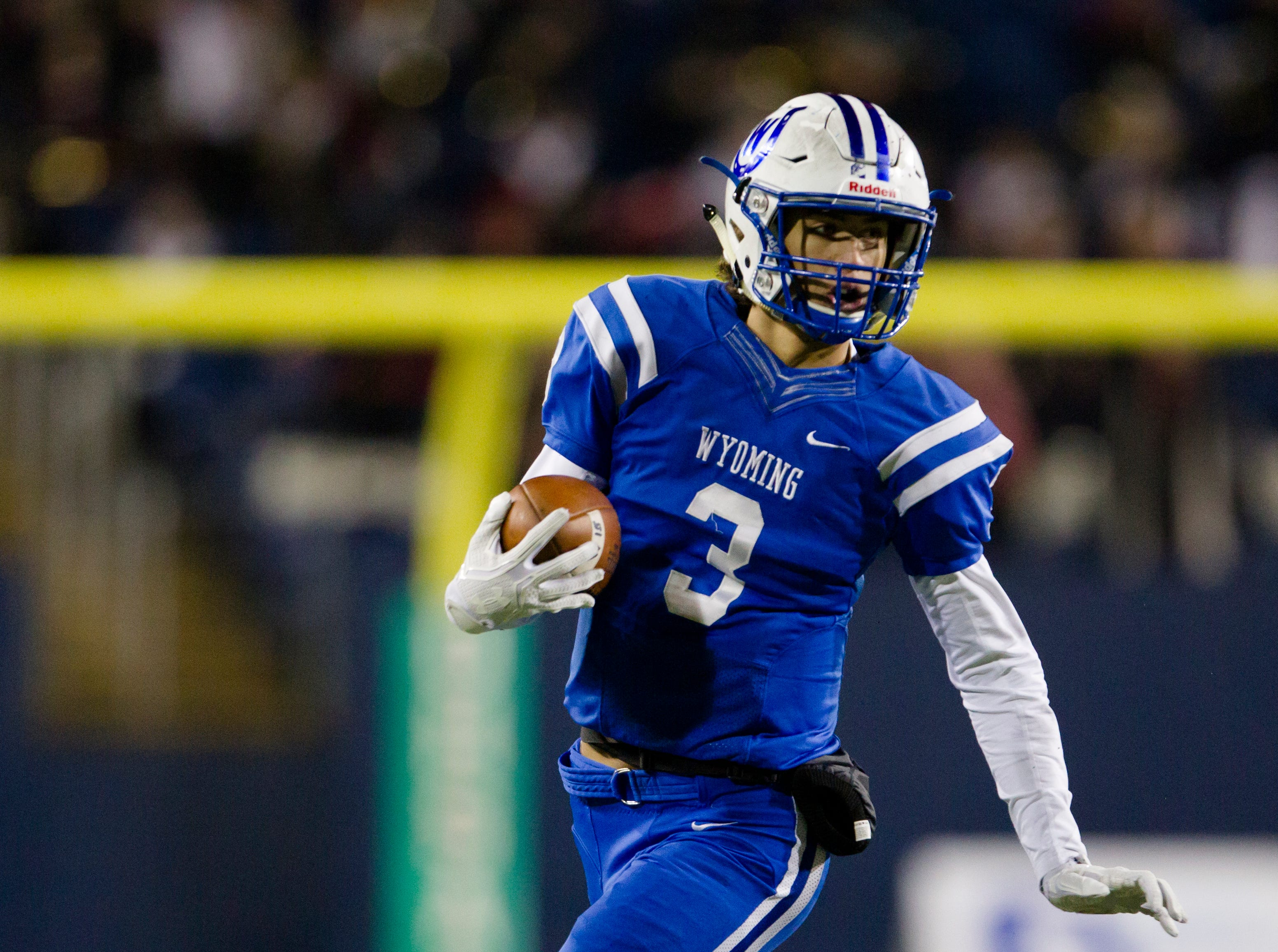 Wyoming's Evan Prater (3) runs downfield during the first half of the OHSAA Division IV State Championship football game between Wyoming and Girard on Saturday, Dec. 1, 2018, at Tom Benson Stadium in Canton.