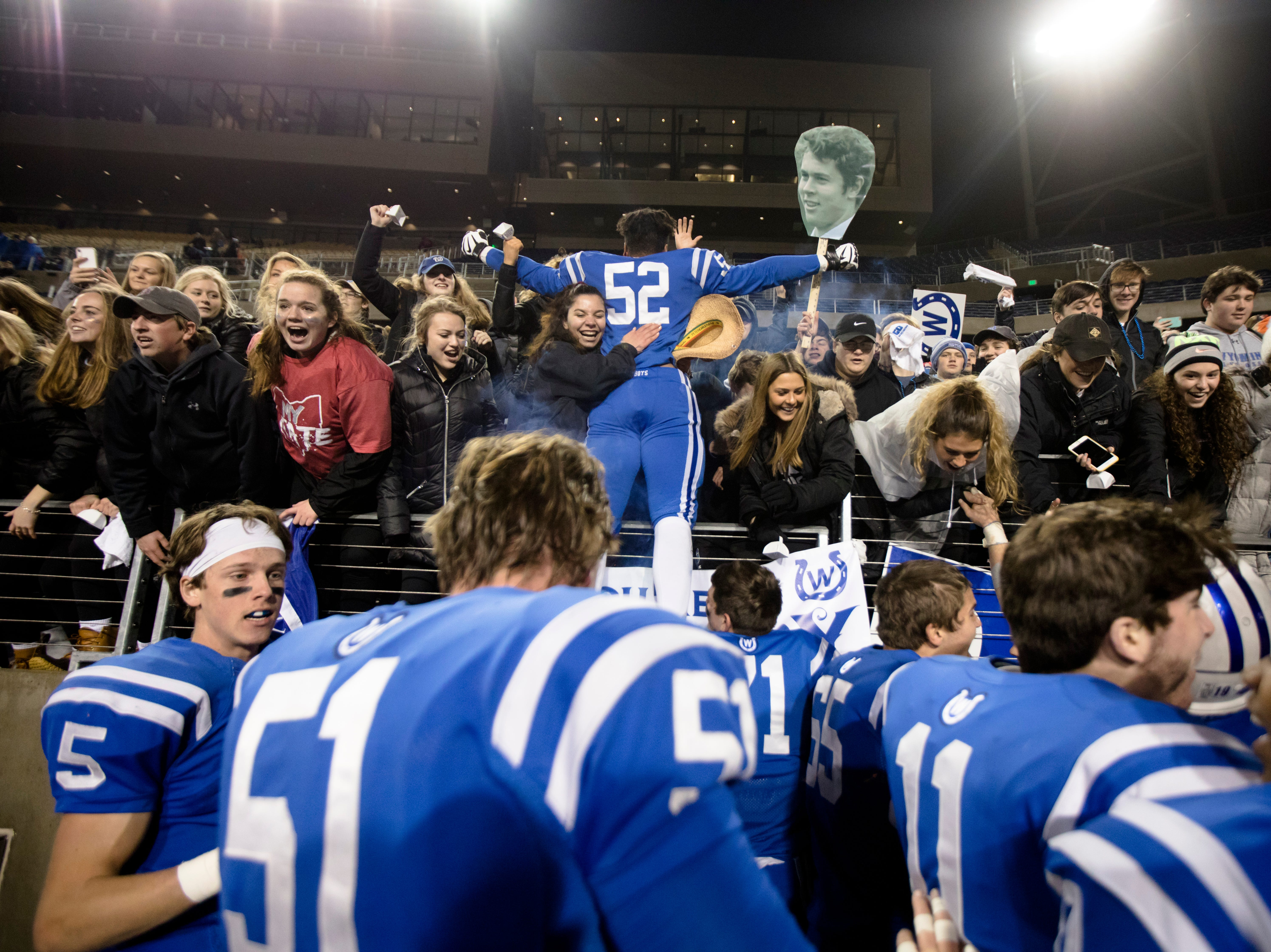 Wyoming's James Smith (52) celebrates with fans celebrate as they win the OHSAA Division IV State Championship football game between Wyoming and Girard on Saturday, Dec. 1, 2018, at Tom Benson Stadium in Canton. Wyoming defeated Girard 42-14.