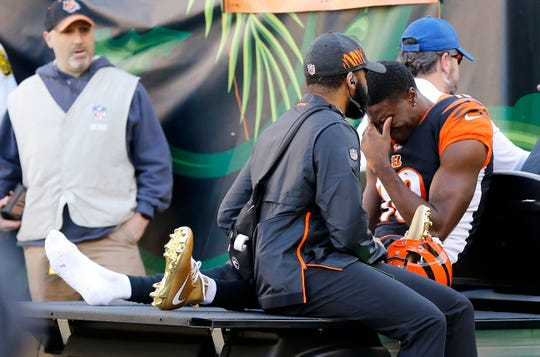 Cincinnati Bengals wide receiver A.J. Green (18) is carted off the field after re-injuring his foot, after missing three games, in the second quarter of the NFL Week 13 game between the Cincinnati Bengals and the Denver Broncos at Paul Brown Stadium in downtown Cincinnati on Sunday, Dec. 2, 2018. The Broncos led 7-3 at halftime.