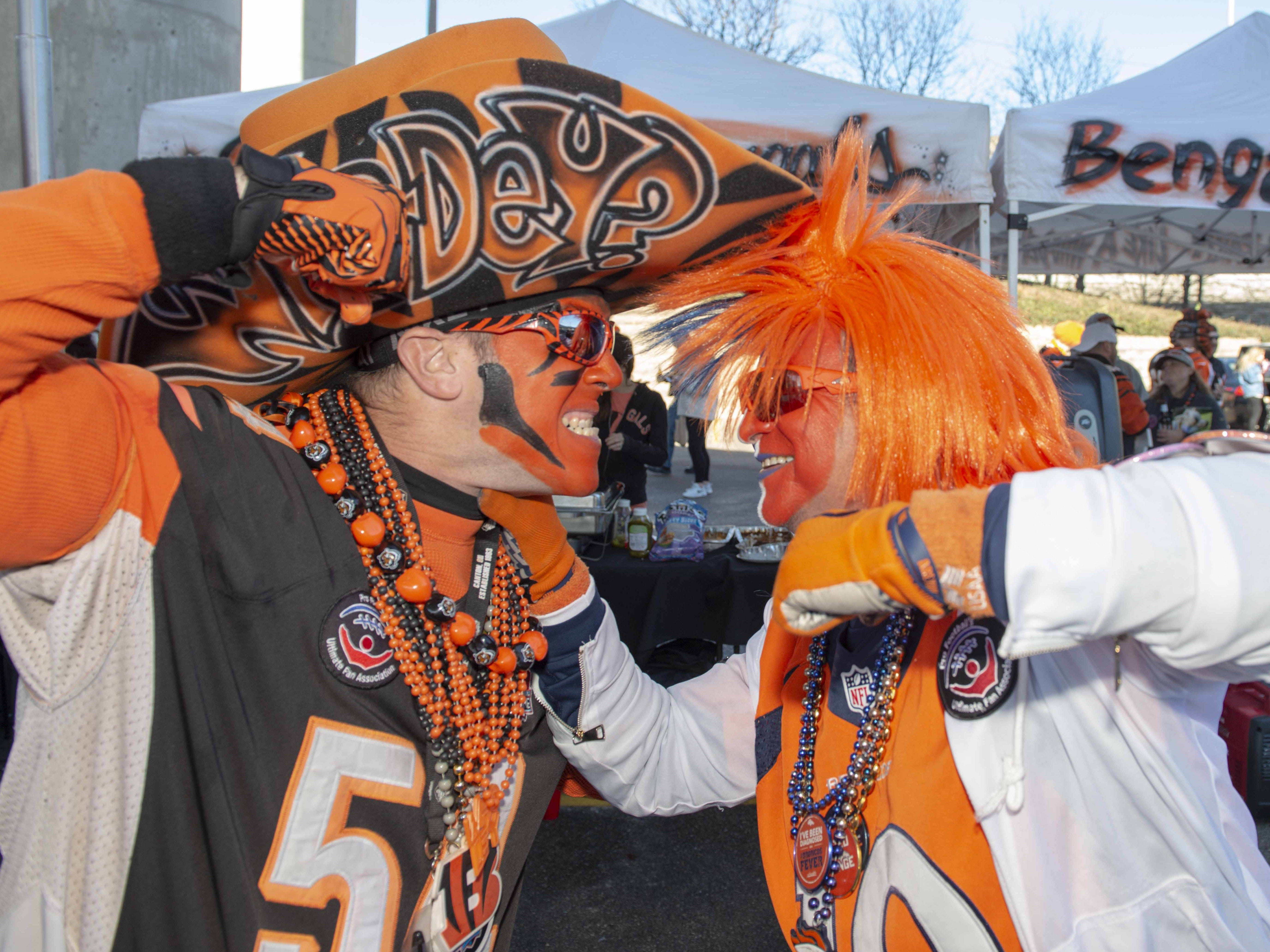 Cincinnati Bengals fans showed up for tailgating parties as the Cincinnati Bengals hosted the Denver Broncos at Paul Brown Stadium Sunday, December 2, 2018. Cincinnati Bengal fan Who Dey Baby and Bronco fan Ken Castanda argue over who is going to win.