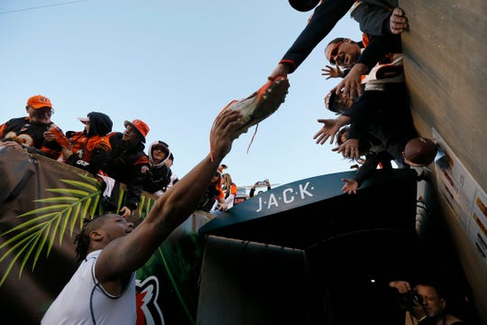 Cincinnati Bengals running back Joe Mixon (28) gives his shoes away to fans after the fourth quarter of the NFL Week 13 game between the Cincinnati Bengals and the Denver Broncos at Paul Brown Stadium in downtown Cincinnati on Sunday, Dec. 2, 2018. The Bengals fell to 5-7 on the season with a 24-10 loss to Denver.