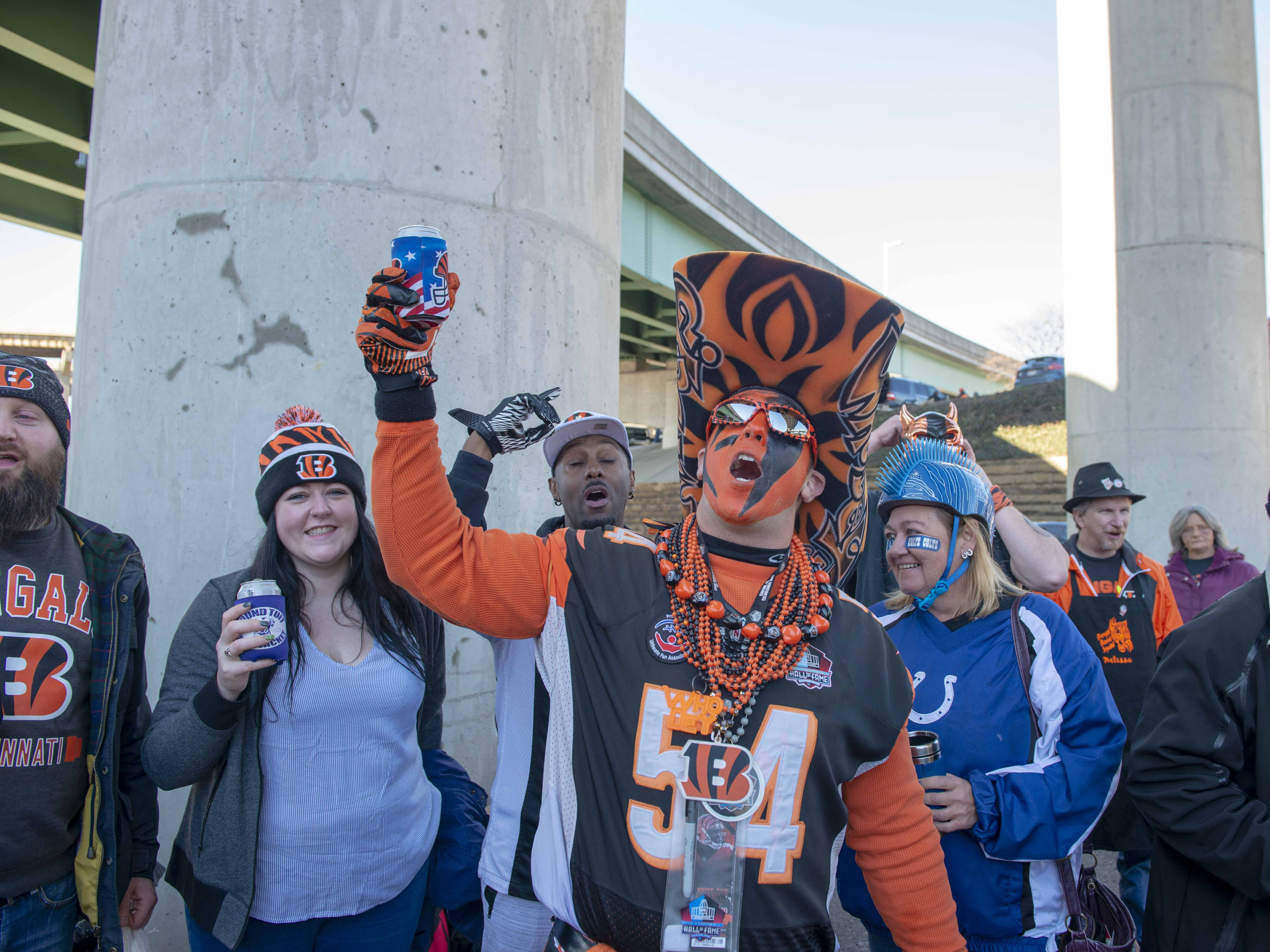 Cincinnati Bengals fans showed up for tailgating parties as the Cincinnati Bengals hosted the Denver Broncos at Paul Brown Stadium Sunday, December 2, 2018. Who Dey Baby enjoys a beer along with a song.