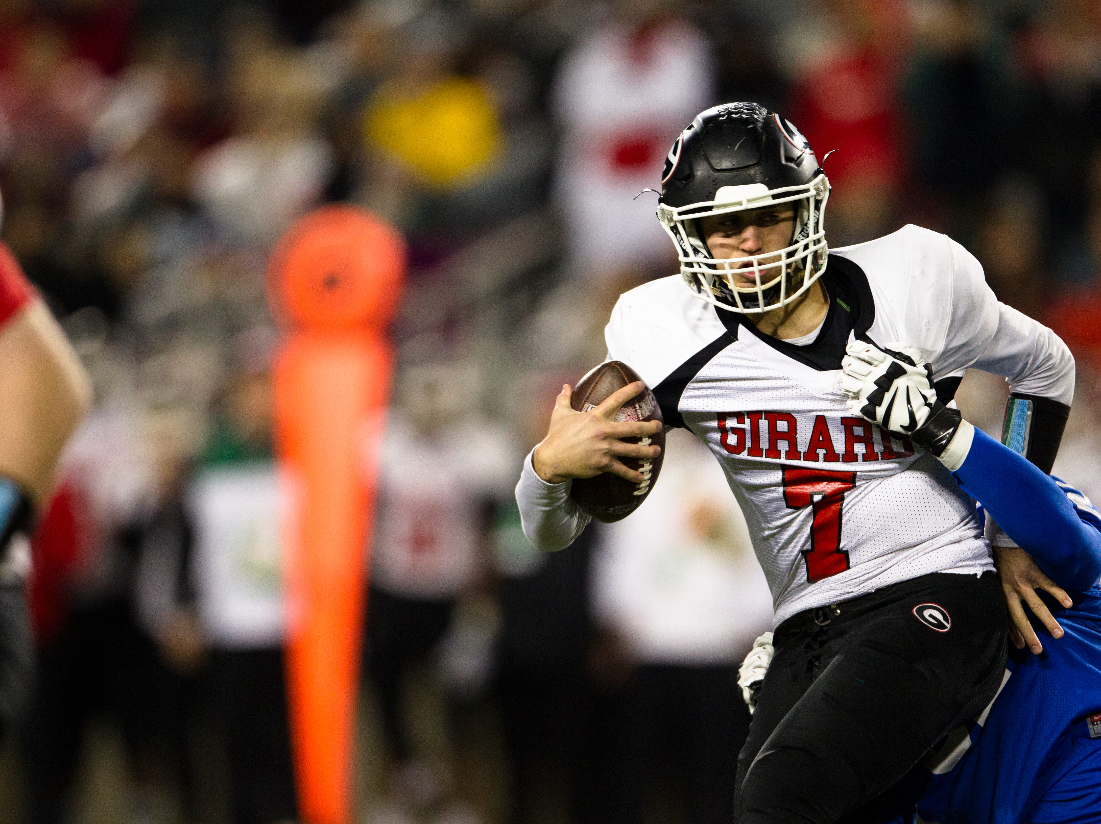 Wyoming's James Smith (52) sacks Girard's Mark Waid (7) during the first half of the OHSAA Division IV State Championship football game between Wyoming and Girard on Saturday, Dec. 1, 2018, at Tom Benson Stadium in Canton.