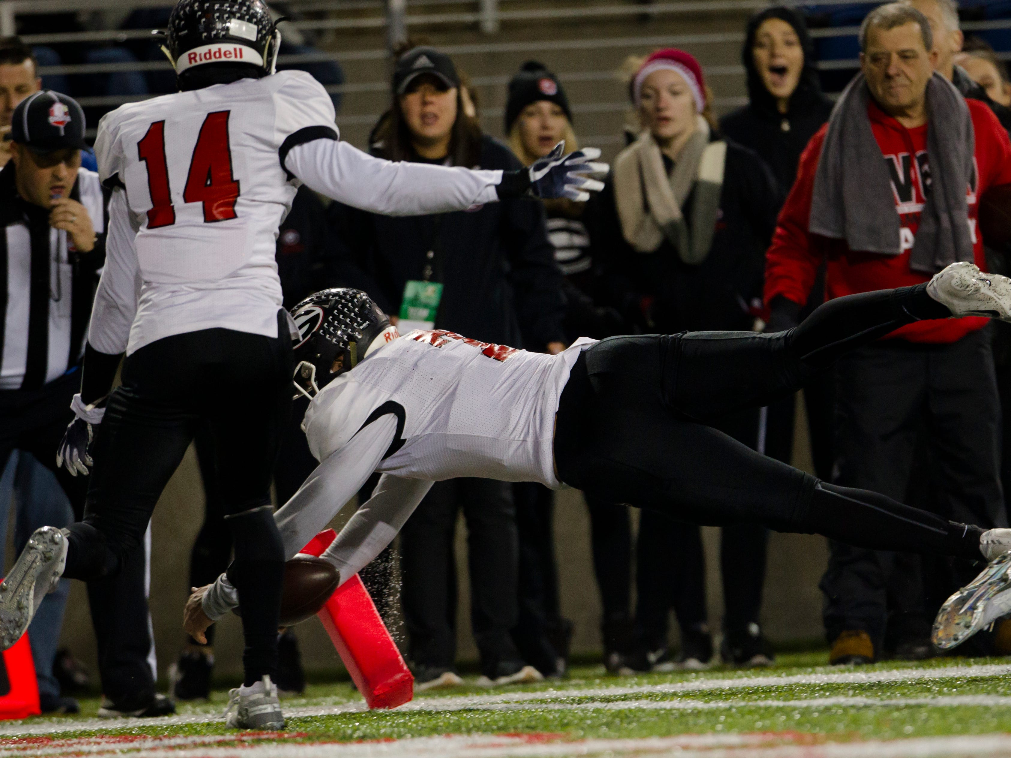 Girard's Mark Waid (7) dives for a touchdown during the first half of the OHSAA Division IV State Championship football game between Wyoming and Girard on Saturday, Dec. 1, 2018, at Tom Benson Stadium in Canton.