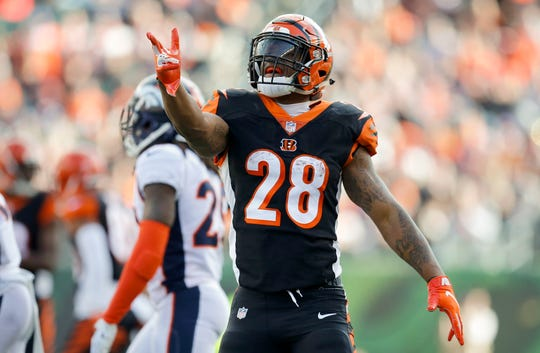 Cincinnati Bengals running back Joe Mixon (28) celebrates after running for a first down in the first quarter of the NFL Week 13 game between the Cincinnati Bengals and the Denver Broncos at Paul Brown Stadium in downtown Cincinnati on Sunday, Dec. 2, 2018. The Broncos led 7-3 at halftime.