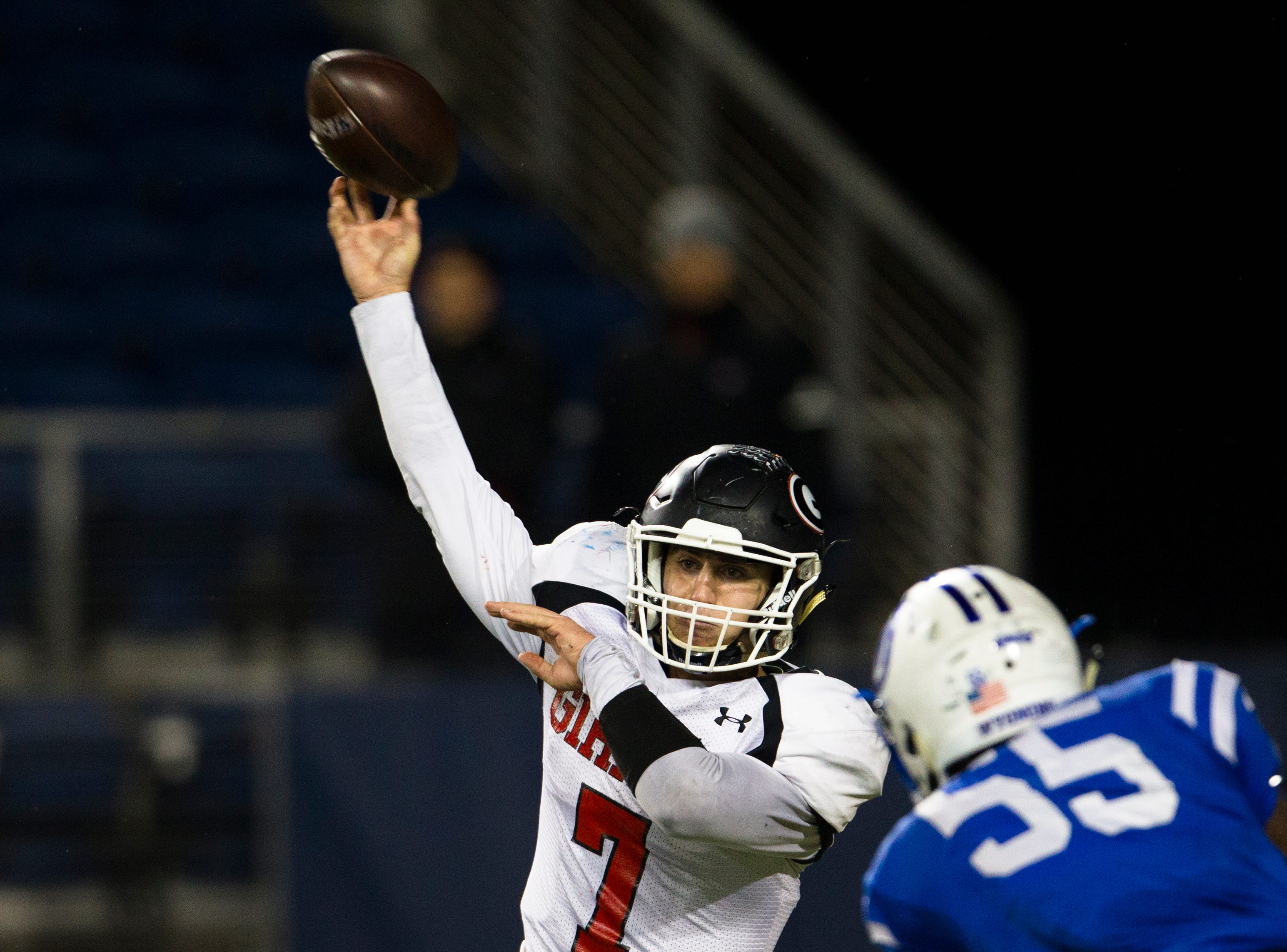 Girard's Mark Waid (7) throws a pass during the first half of the OHSAA Division IV State Championship football game between Wyoming and Girard on Saturday, Dec. 1, 2018, at Tom Benson Stadium in Canton.