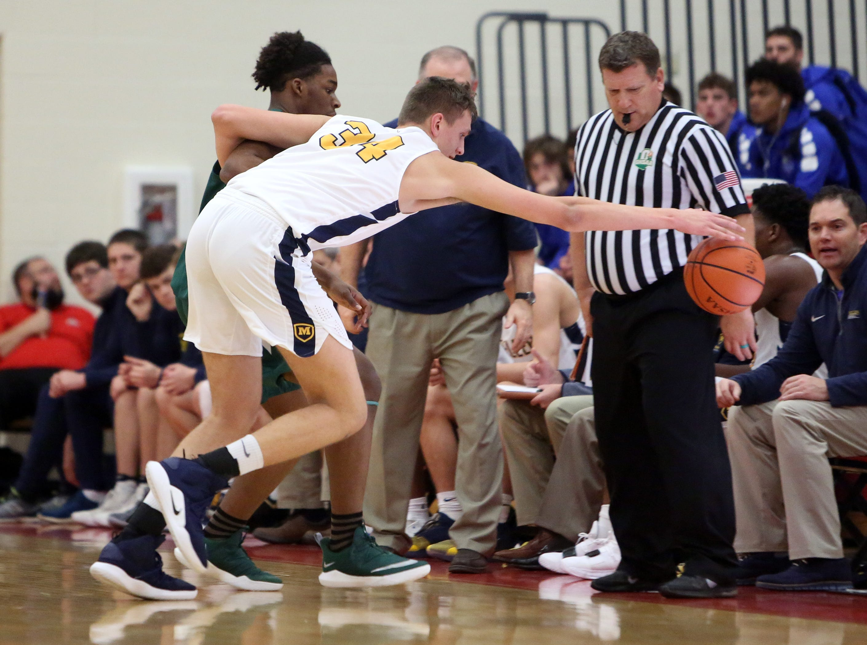 Moeller center Logan Holcomb can't get to this loose ball at the Ohio Valley Hoops Classic at Hillsboro High School. Moeller defeated Bryan Station 85-42.