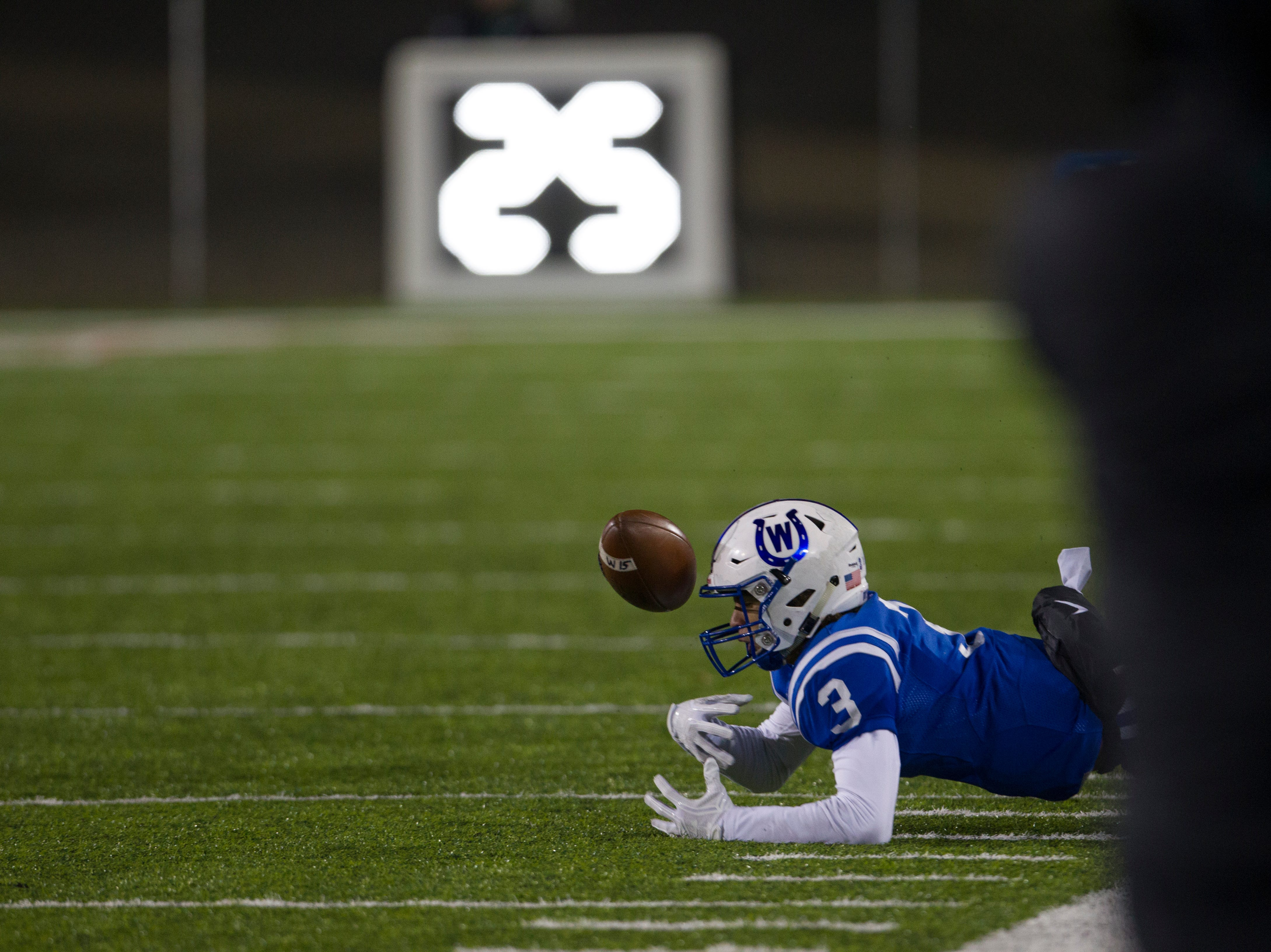 Wyoming's Evan Prater (3) fumbles during the first half of the OHSAA Division IV State Championship football game between Wyoming and Girard on Saturday, Dec. 1, 2018, at Tom Benson Stadium in Canton.