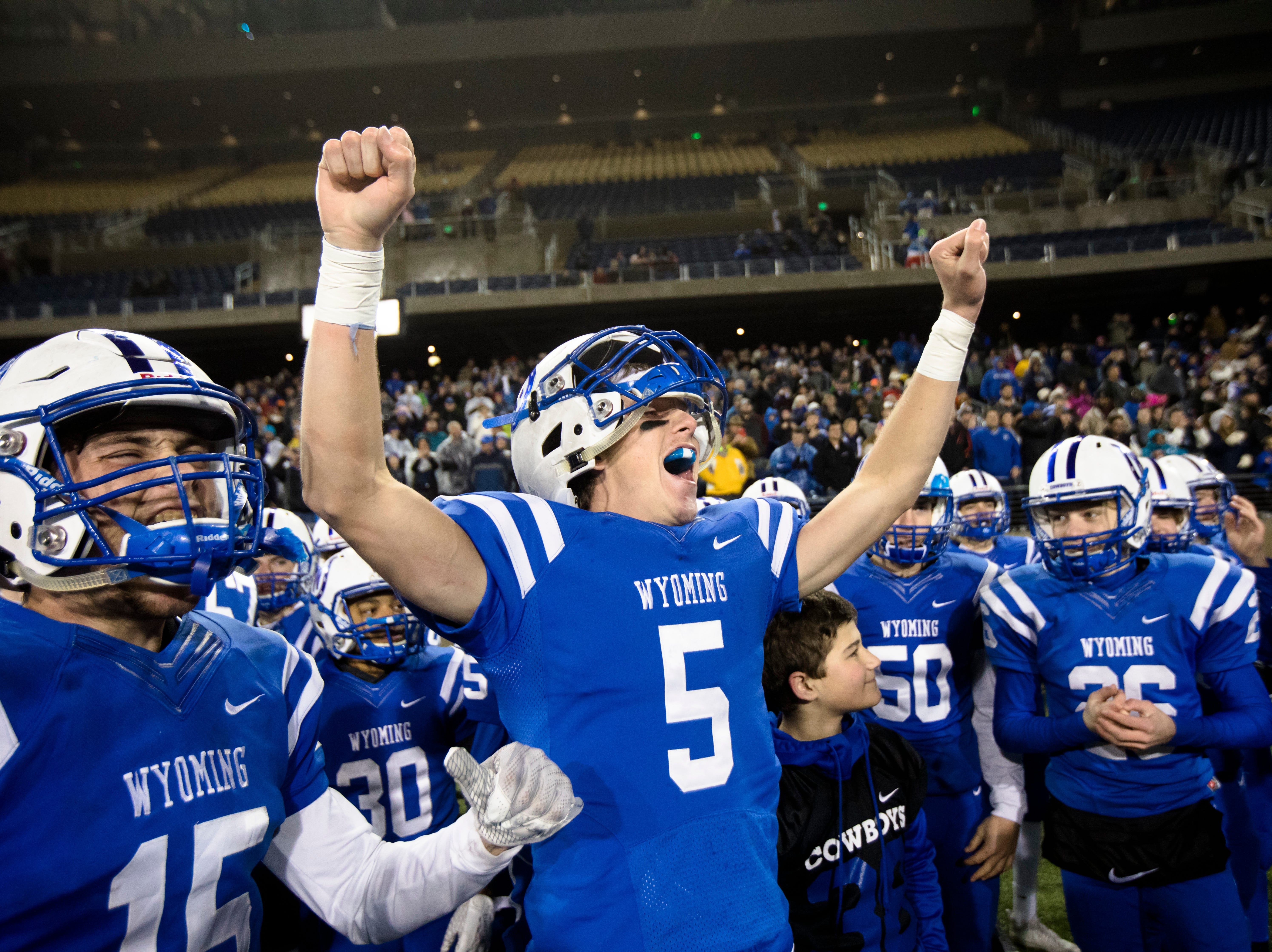 Wyoming's Perry McMichen (15) and Wyoming's Sam Pendery (5) celebrate as they win the OHSAA Division IV State Championship football game between Wyoming and Girard on Saturday, Dec. 1, 2018, at Tom Benson Stadium in Canton. Wyoming defeated Girard 42-14.