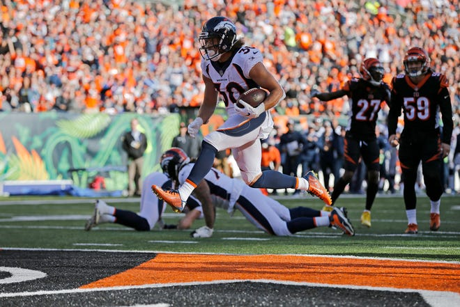 Denver Broncos running back Phillip Lindsay (30) high steps into the end zone for a touchdown in the second quarter of the NFL Week 13 game between the Cincinnati Bengals and the Denver Broncos at Paul Brown Stadium in downtown Cincinnati on Sunday, Dec. 2, 2018. The Broncos led 7-3 at halftime.