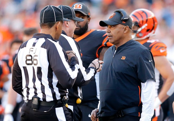 Cincinnati Bengals head coach Marvin Lewis talks with officials between plays quarter of the NFL Week 13 game between the Cincinnati Bengals and the Denver Broncos at Paul Brown Stadium in downtown Cincinnati on Sunday, Dec. 2, 2018. The Broncos led 7-3 at halftime.