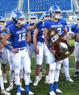 The Covington Catholic Colonels accept the KHSAA 5A state football runners-up trophy, December 2, 2018.
