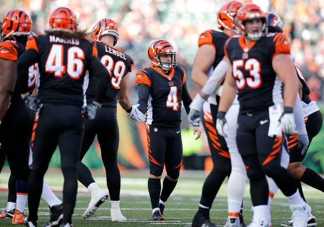 Cincinnati Bengals kicker Randy Bullock (4) shakes hands after a successful field goal in the second quarter of the NFL Week 13 game between the Cincinnati Bengals and the Denver Broncos at Paul Brown Stadium in downtown Cincinnati on Sunday, Dec. 2, 2018. The Broncos led 7-3 at halftime.