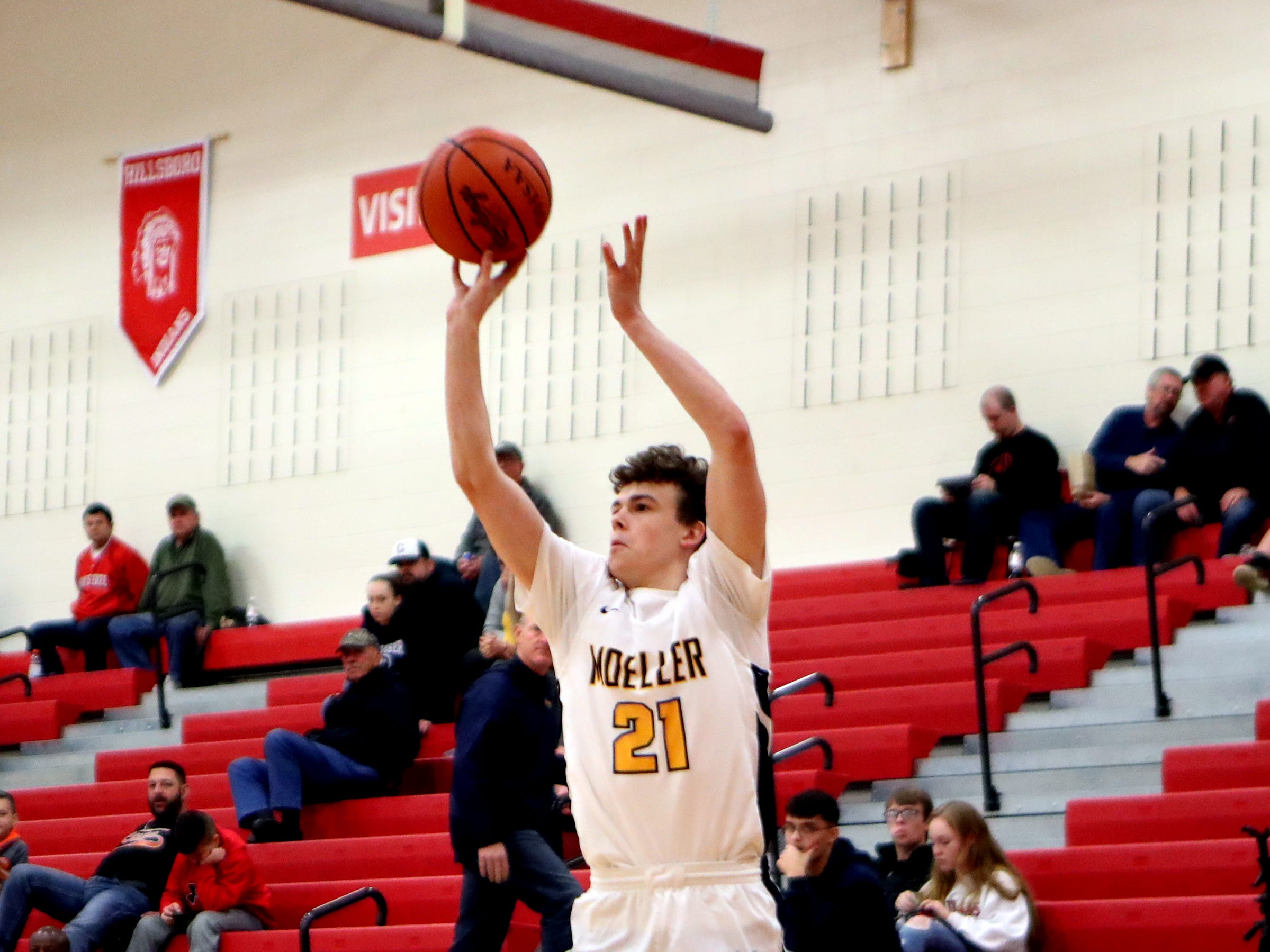 Moeller guard Brad Colbert knocks this shot down for a three pointer at the Ohio Valley Hoops Classic at Hillsboro High School. Moeller defeated Bryan Station 85-42.