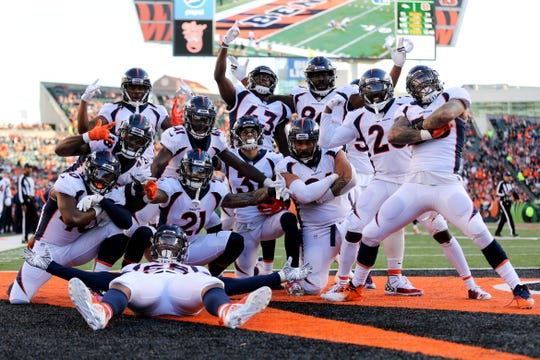 The Denver Broncos defense poses for a photo after a fumble recovery in the third quarter of a Week 13 NFL football game, Sunday, Dec. 2, 2018, at Paul Brown Stadium in Cincinnati. The Denver Broncos won 24-10 and the Cincinnati Bengals fell to 5-7 on the season with the loss.