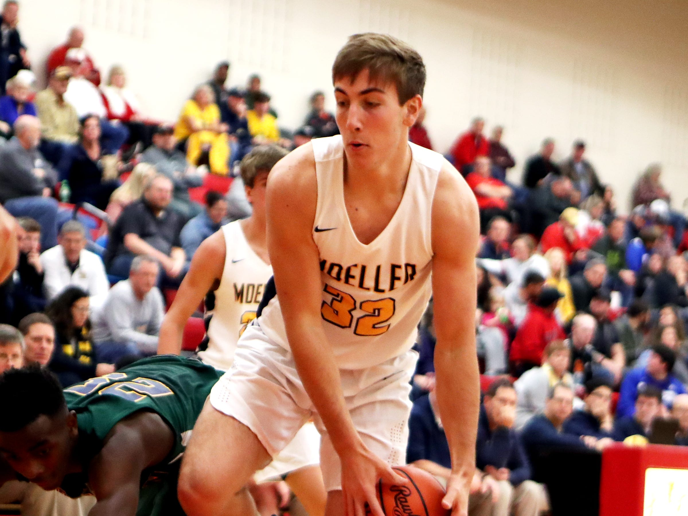 Moeller forward Patrick Suter can't save the ball from going out of bounds at the Ohio Valley Hoops Classic at Hillsboro High School. Moeller defeated Bryan Station 85-42.