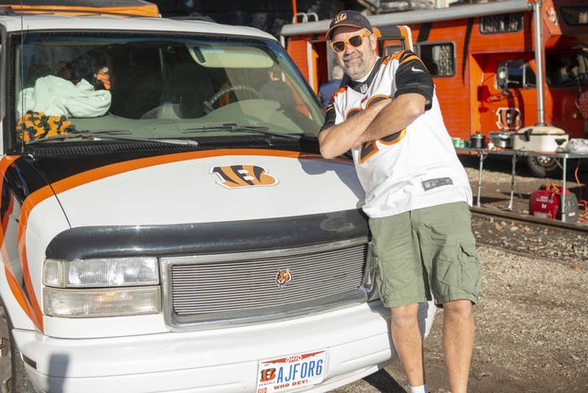 Bengals fan Ron Patton of Cass Town, tailgates on a warm Sunday, Dec. 2, before the game against the Denver Broncos at Paul Brown Stadium.