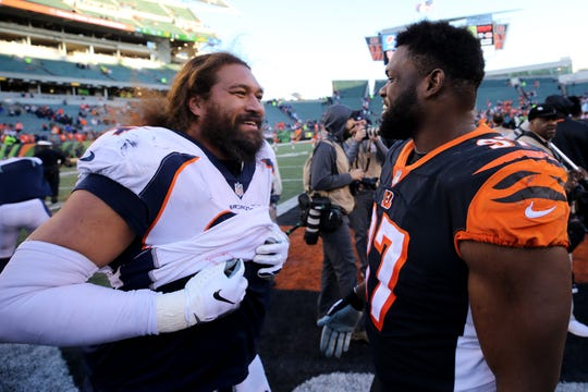 Denver Broncos nose tackle Domata Peko (94) and Cincinnati Bengals defensive tackle Geno Atkins (97) talk after a Week 13 NFL football game, Sunday, Dec. 2, 2018, at Paul Brown Stadium in Cincinnati. The Denver Broncos won and the Cincinnati Bengals fell to 5-7 on the season with the loss.
