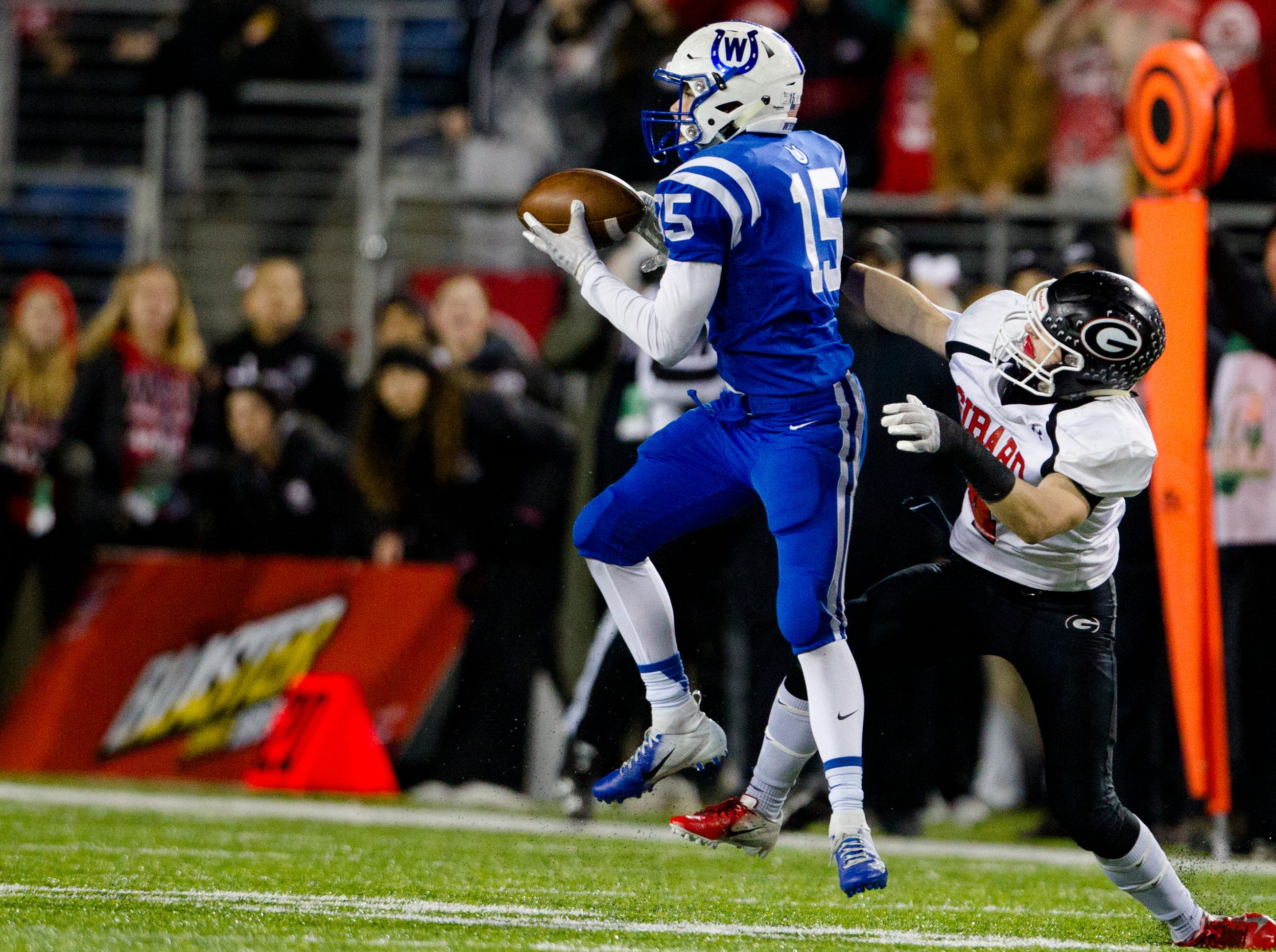 Wyoming's Perry McMichen (15) catches a pass during the second half of the OHSAA Division IV State Championship football game between Wyoming and Girard on Saturday, Dec. 1, 2018, at Tom Benson Stadium in Canton.