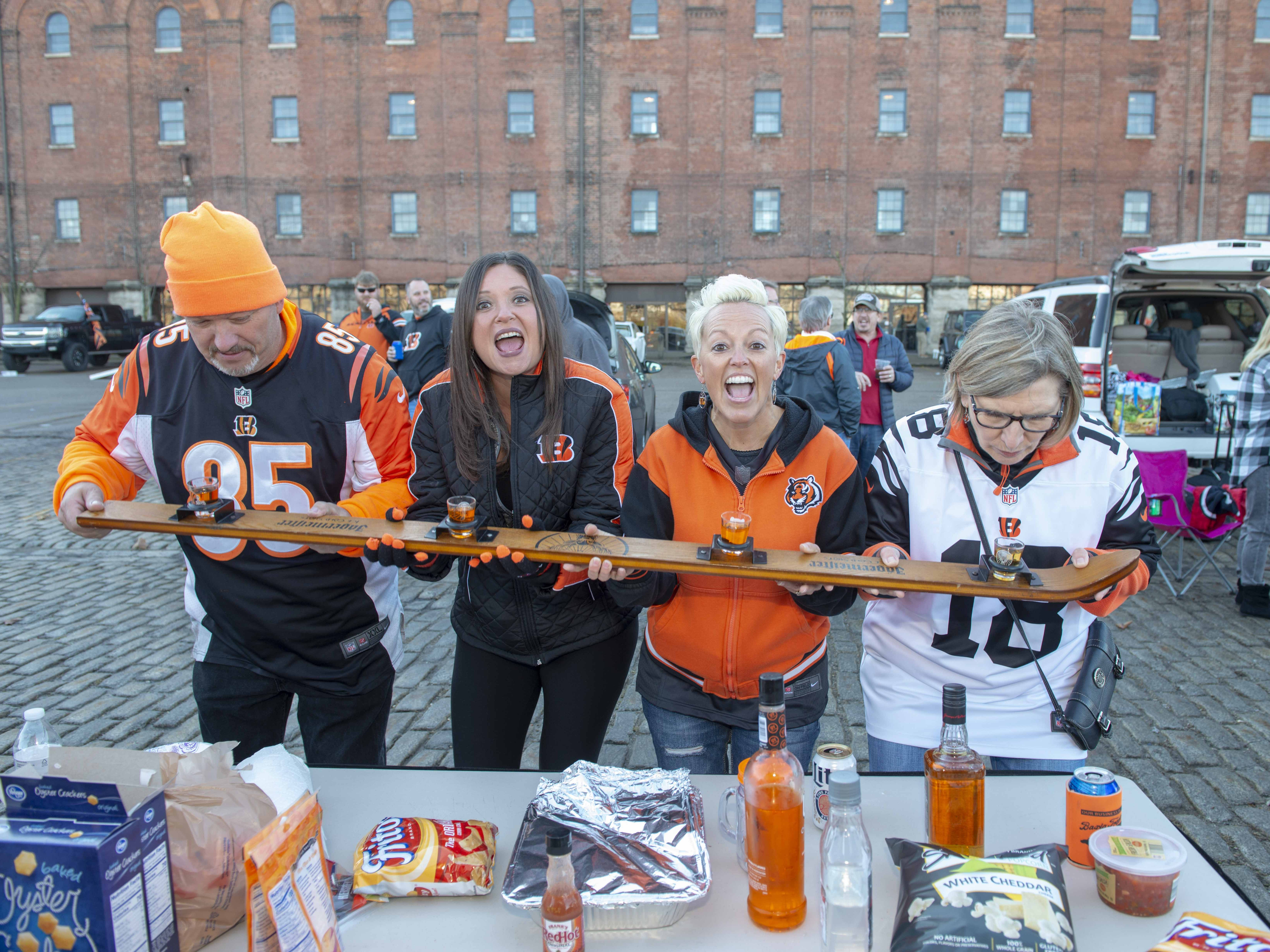 Cincinnati Bengals fans showed up for tailgating parties as the Cincinnati Bengals hosted the Denver Broncos at Paul Brown Stadium Sunday, December 2, 2018. George Wollam, Angela Bruce, DJ Hendricks and Joanne Bodder with a flight of VU Vodka.
