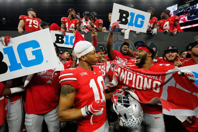 Dec 1, 2018; Indianapolis, IN, USA; Ohio State Buckeyes celebrate after defeating the Northwestern Wildcats in the Big Ten conference championship game at Lucas Oil Stadium.