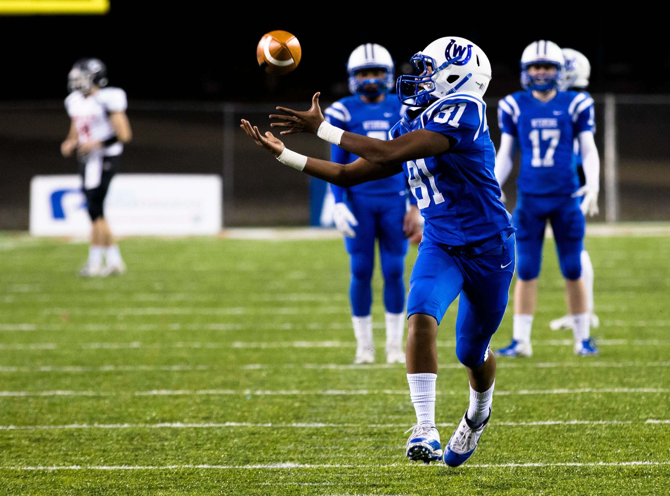 Wyoming's Isaiah Tidjani (81) catches a pass while warming up before the OHSAA Division IV State Championship football game between Wyoming and Girard on Saturday, Dec. 1, 2018, at Tom Benson Stadium in Canton.