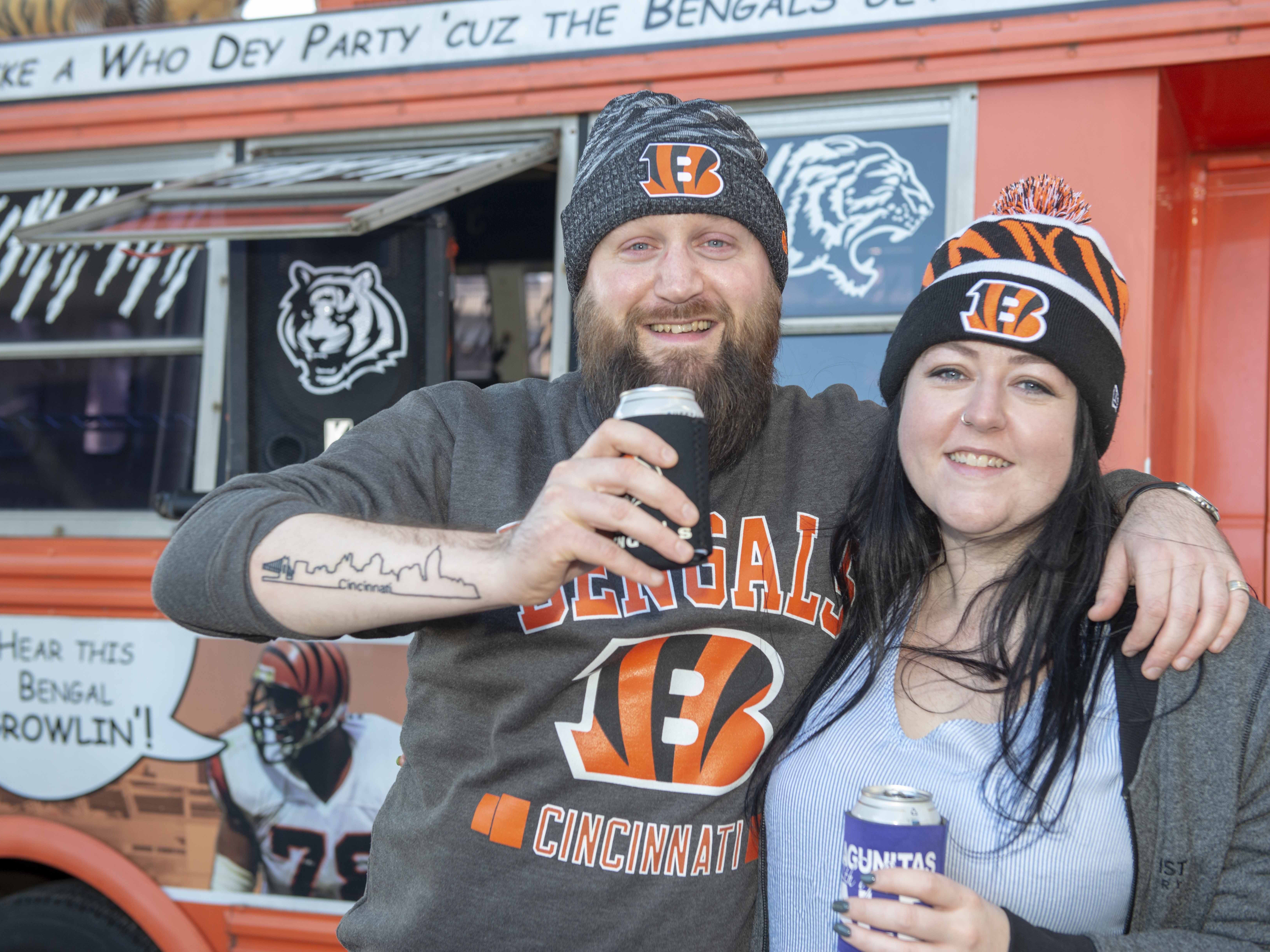 Cincinnati Bengals fans showed up for tailgating parties as the Cincinnati Bengals hosted the Denver Broncos at Paul Brown Stadium Sunday, December 2, 2018. Loyal Cincinnati Bengal fans come from all over the globe.  Scott Gibb and Vicky Caird come for the tailgating and the game from Edinburgh, Scotland.