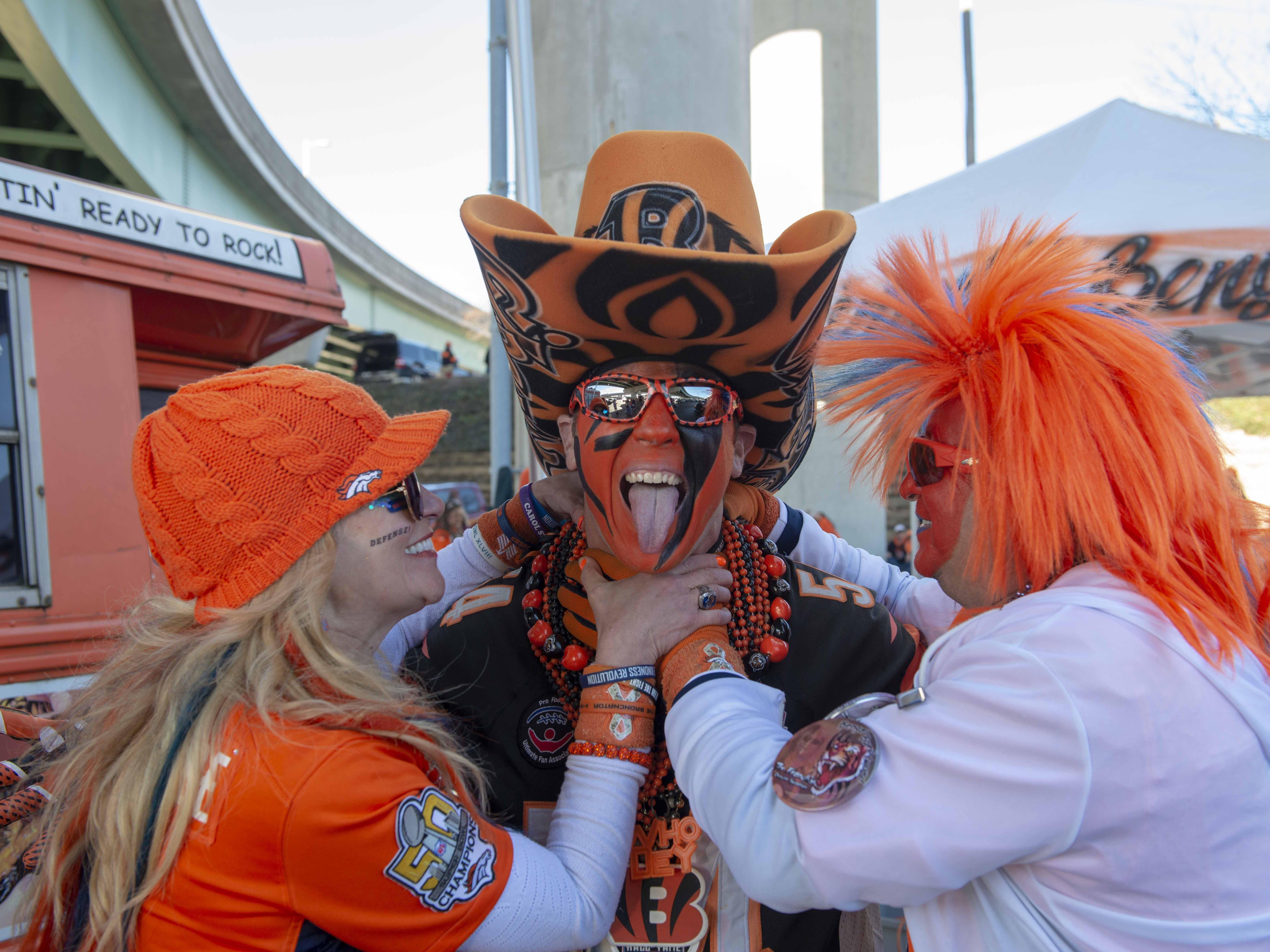 Cincinnati Bengals fans showed up for tailgating parties as the Cincinnati Bengals hosted the Denver Broncos at Paul Brown Stadium Sunday, December 2, 2018. Denver Bronco fans Catherine Highland and Ken Castaneda attack Who Dey Baby.